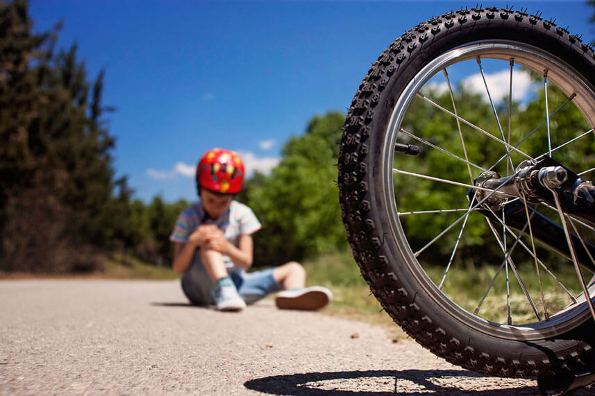 boy with bicycle injury