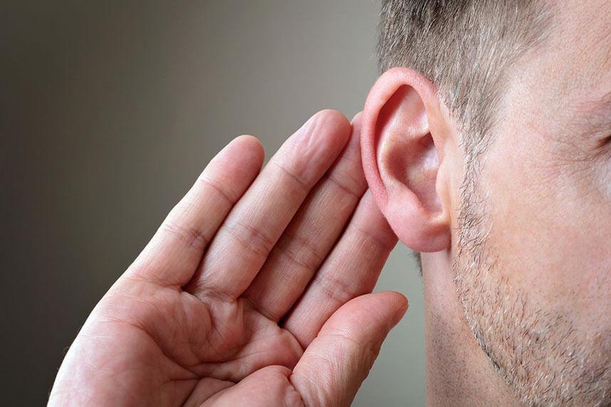 man holding ear