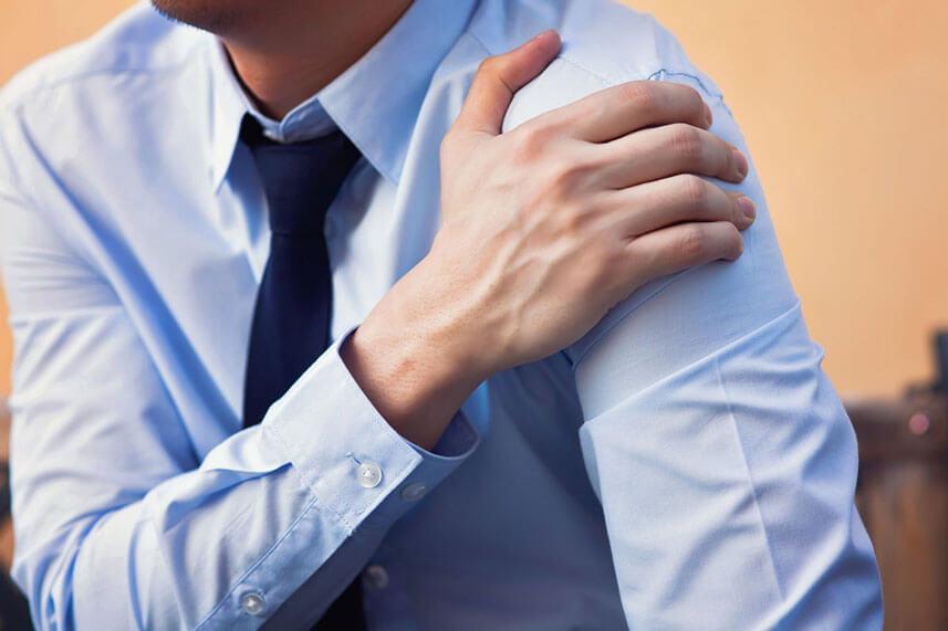 man holding shoulder