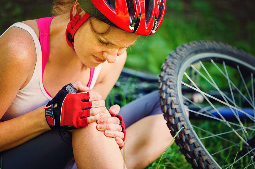 woman with bicycle injury