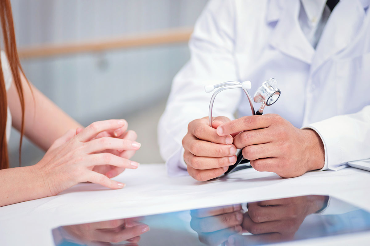 Doctor and patient hands